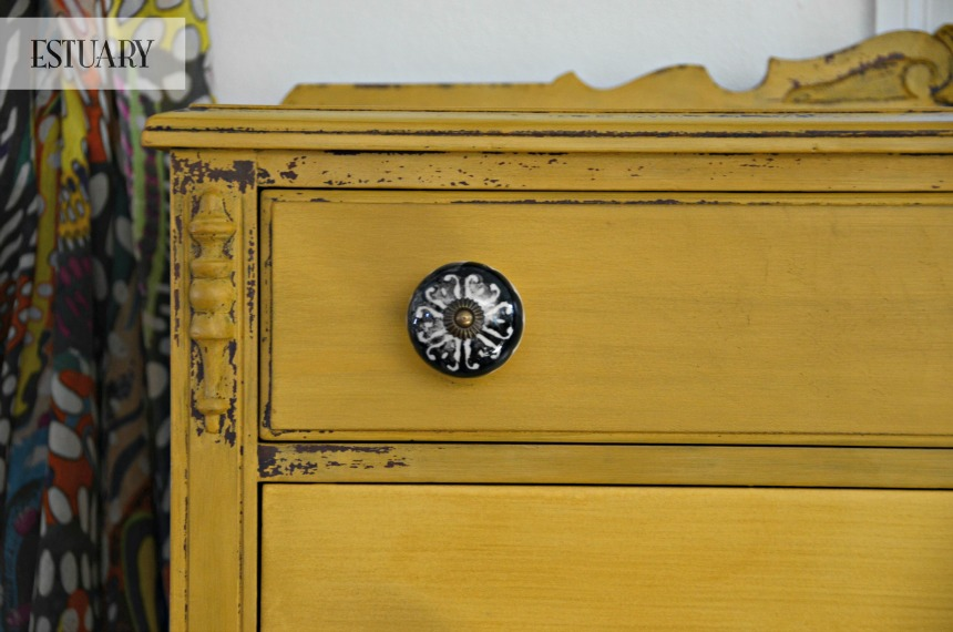 Mustard Dresser close-up picture with black and white knobs