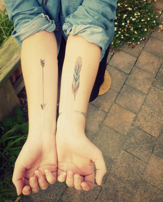 Arrow and feather tattoo from Berlinrose