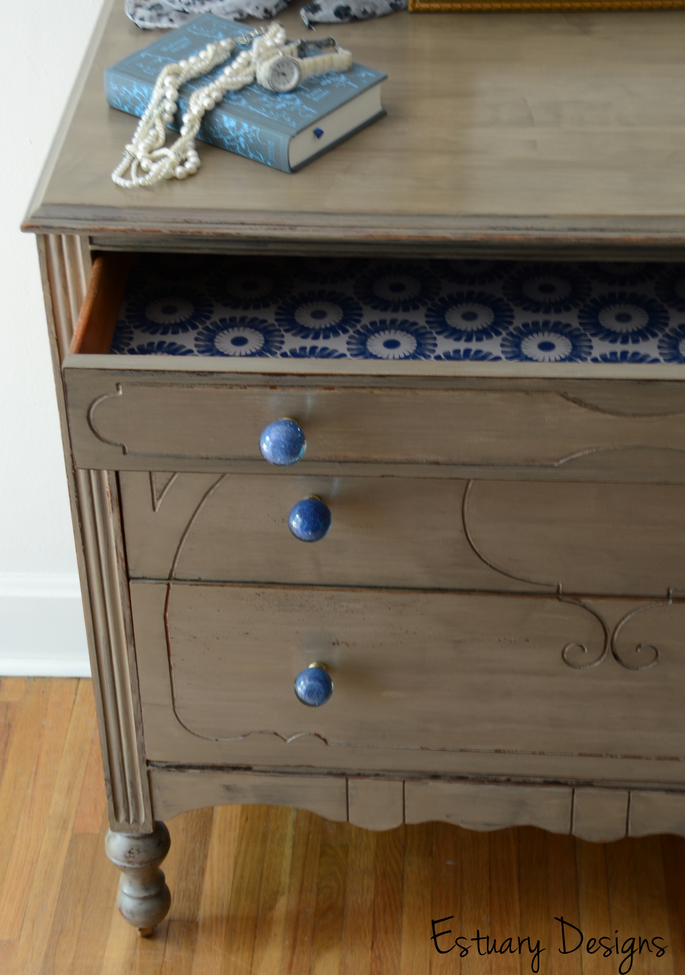 nerissa a driftwood esque three drawer dresser with blue glass knobs