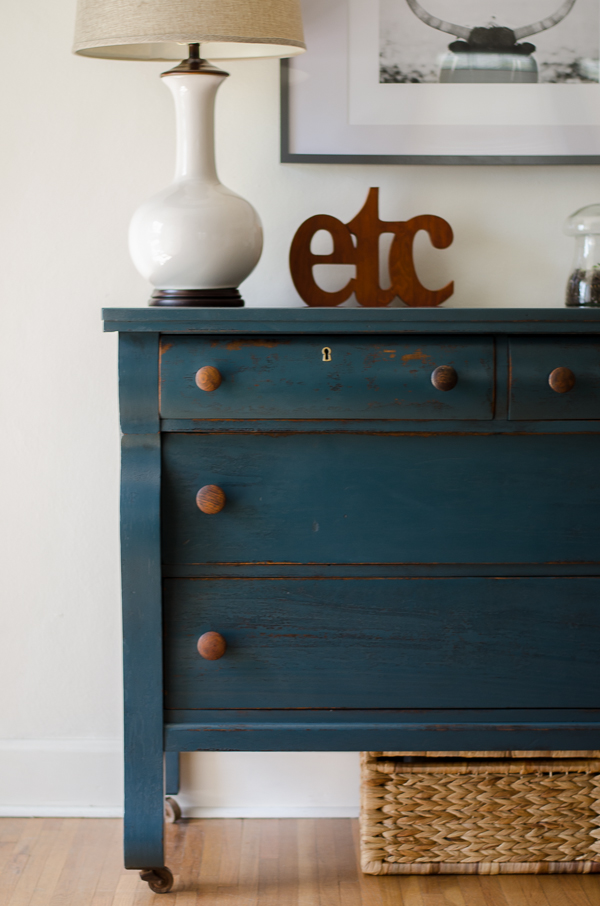 Empire dresser painted in a deep green/blue with wood knobs